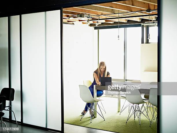 Businesswoman working on digital tablet in office