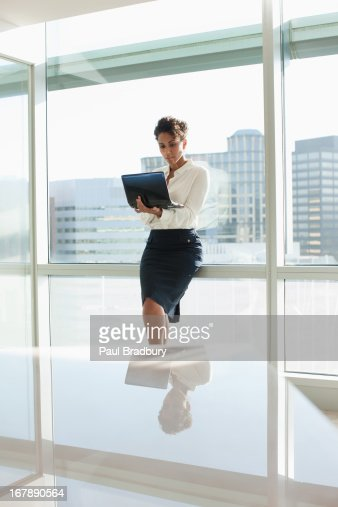 Businesswoman working on laptop in office : Stock Photo