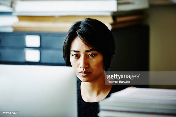 Businesswoman working on project in startup office