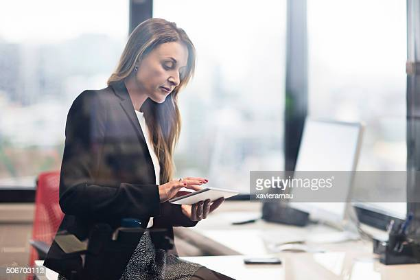Businesswoman working with a digital tablet
