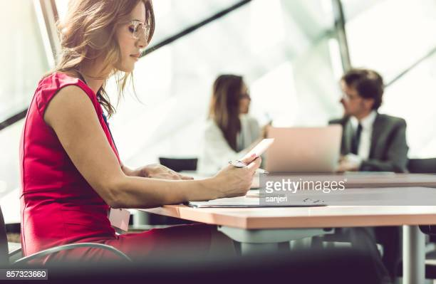 Businesswoman working With Colleagues Behind