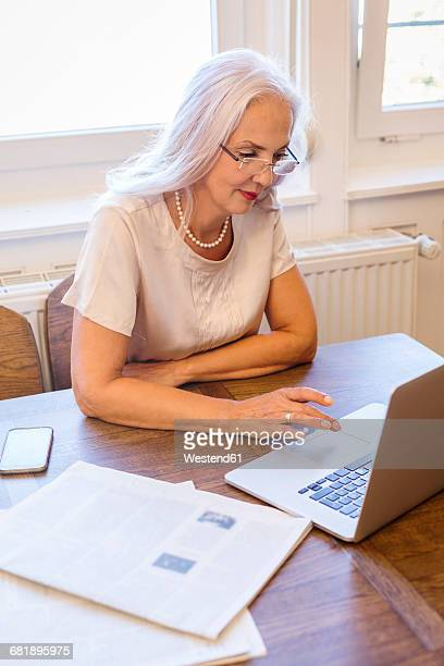 Businesswoman working with laptop at home