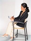 Businesswoman writing check