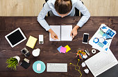 Businesswoman making to do list on diary