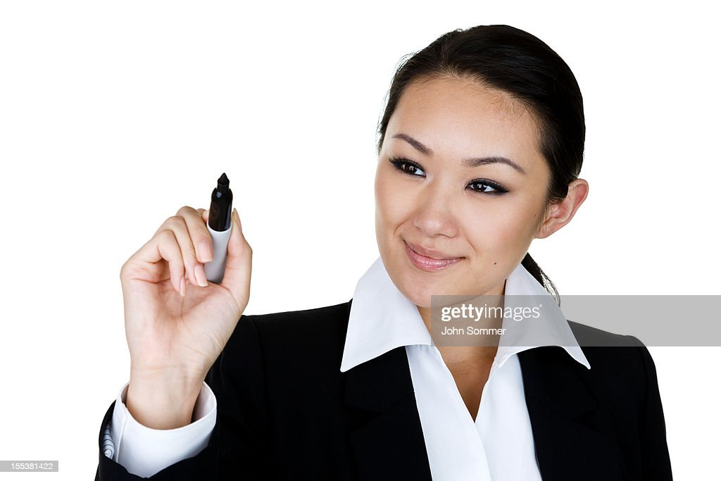 Businesswoman writing on clear board