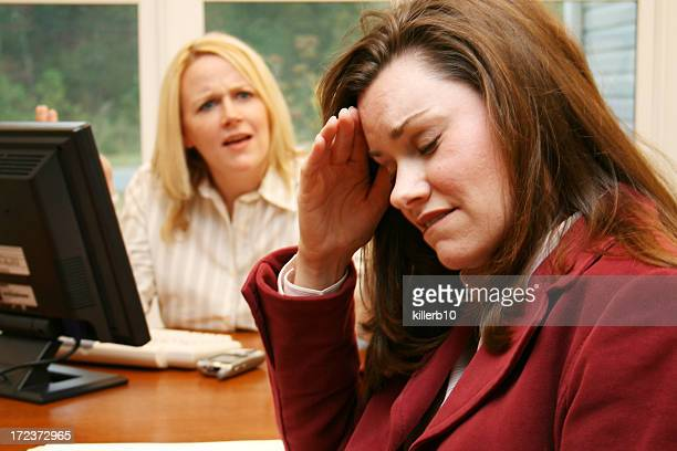 Businesswoman yelling at another upset businesswoman