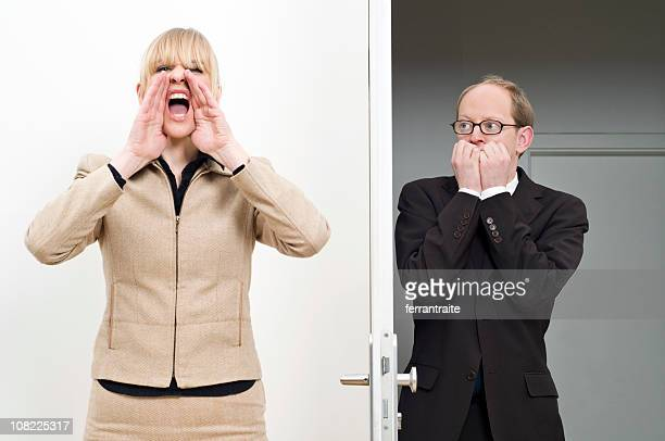 Businesswoman Yelling For Scared Businessman