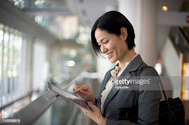 Businesswoman you are using a tablet