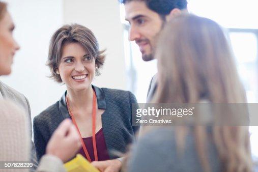 Businesswomen and businessman meeting in conference centre atrium