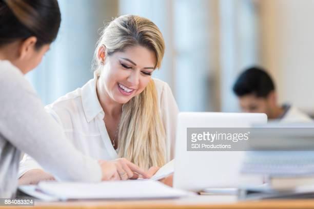 Businesswomen discuss financial items