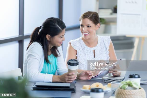 Businesswomen discuss something together