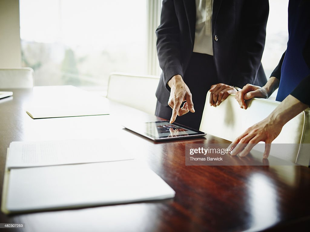 Businesswomen discussing project in hotel suite : Stock Photo