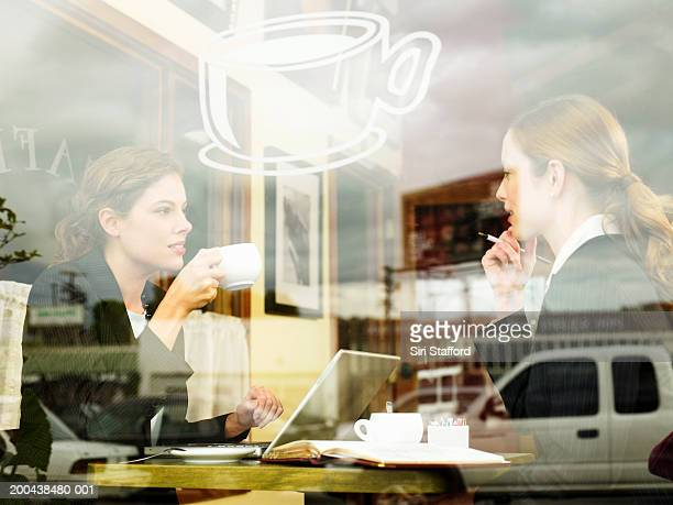 Businesswomen having coffee in cafe