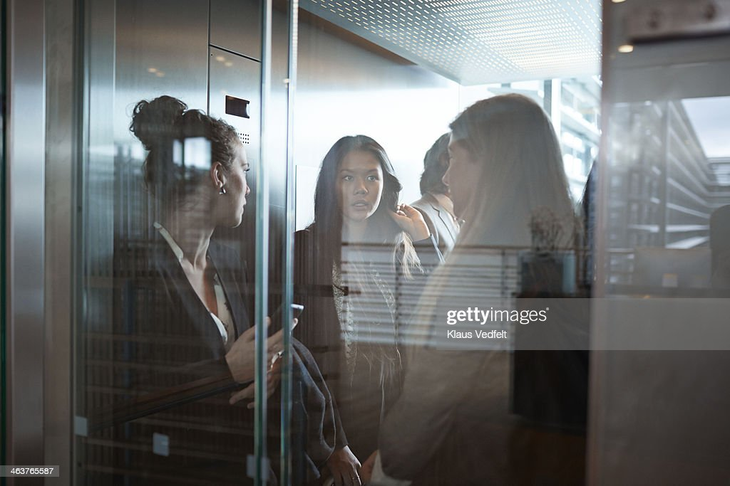 Businesswomen having discussion in elevator