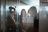 Businesswomen having discussion in elevator