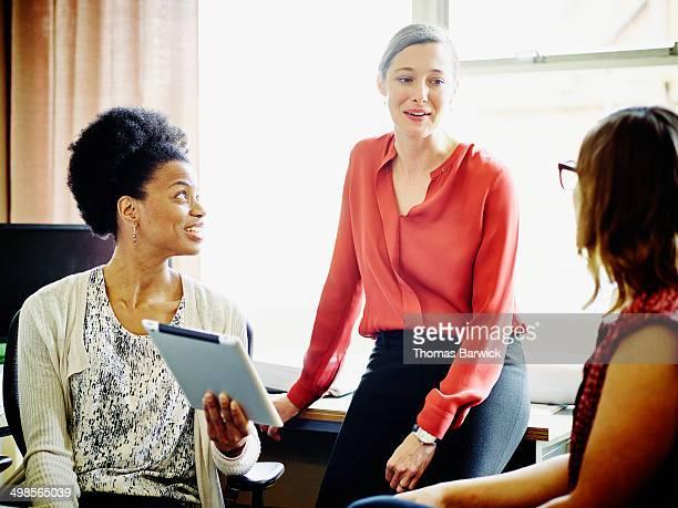 Businesswomen having informal meeting in office