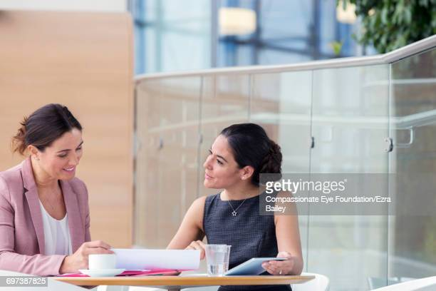 Businesswomen having meeting in cafe