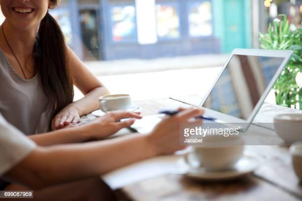 Businesswomen having meeting in coffee bar, London