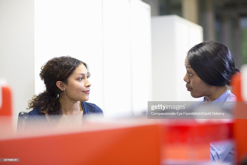 Businesswomen having meeting in modern office : Stock Photo