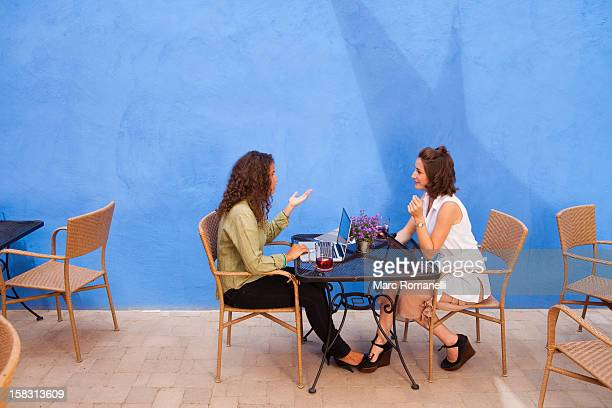 Businesswomen having meeting in outdoor cafe