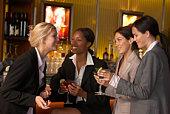 Businesswomen holding martinis