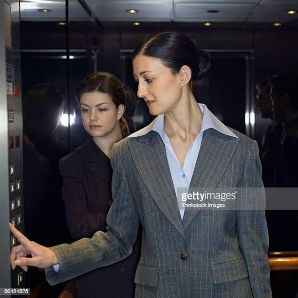 Businesswomen in elevator