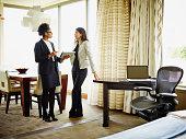 Businesswomen in looking at digital tablet