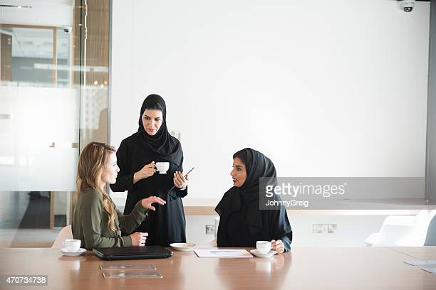 Businesswomen in Middle East office meeting