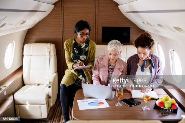 Businesswomen in private jet airplane