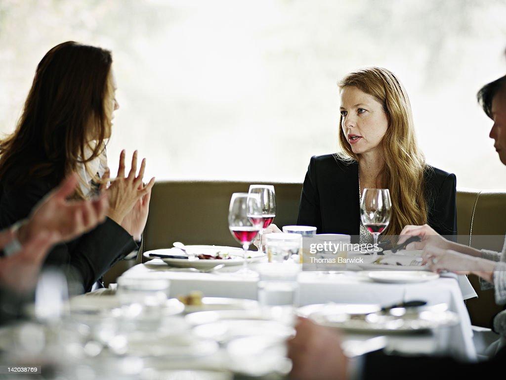 Businesswomen in restaurant having meeting : Stock Photo