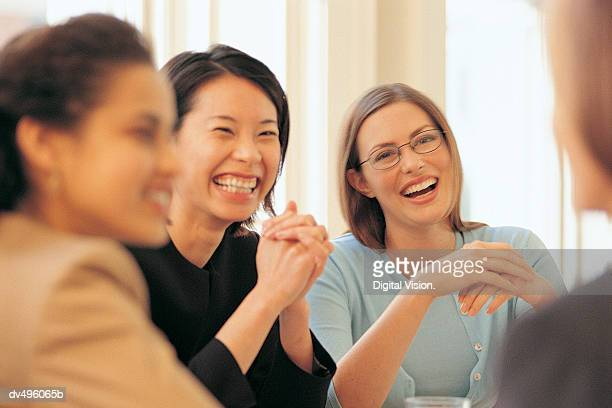 Businesswomen laughing in meeting