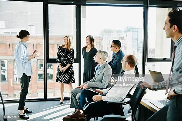 Businesswomen leading team meeting