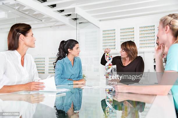 businesswomen listening to scientists