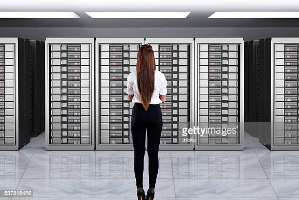Businesswomen looking at server