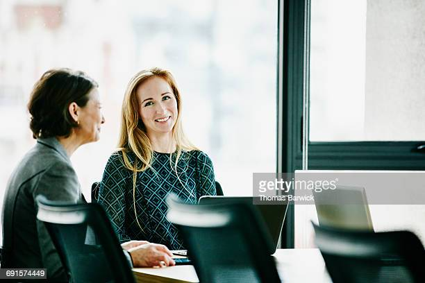 Businesswomen meeting in office conference room