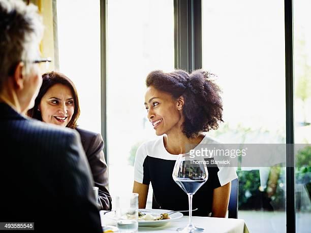 Businesswomen meeting over lunch in restaurant