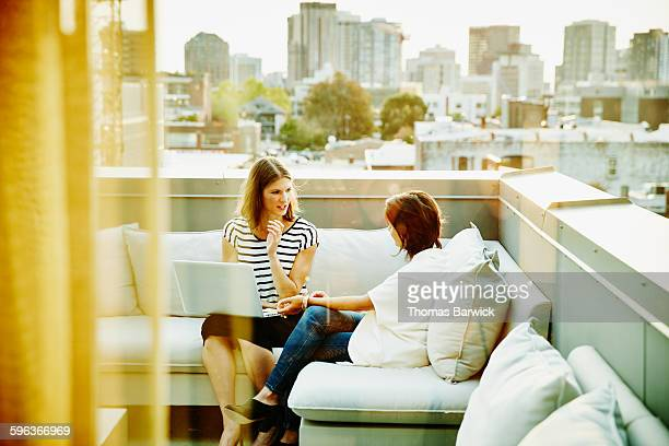Businesswomen on office terrace discussing project