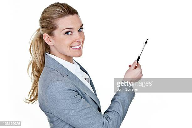 Businesswomen pointing to copy space