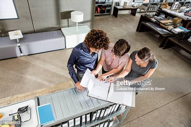 Businesswomen reading in office