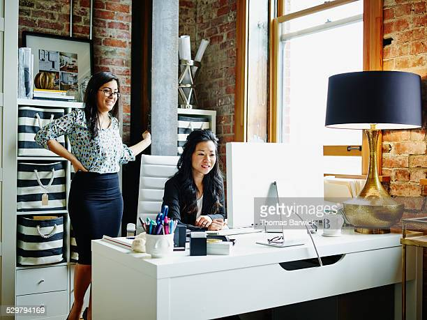 Businesswomen reviewing project on computer