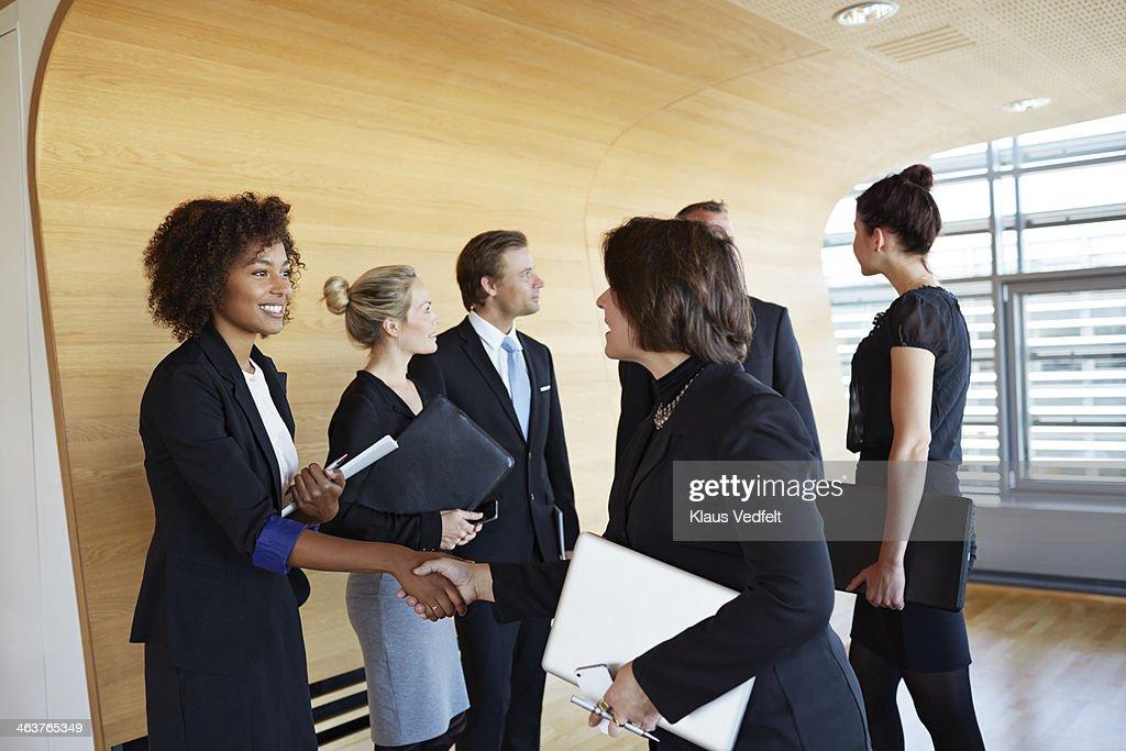 Businesswomen shaking hands before big meeting : Stock Photo
