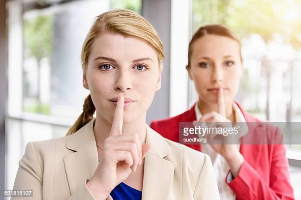Businesswomen sharing secret