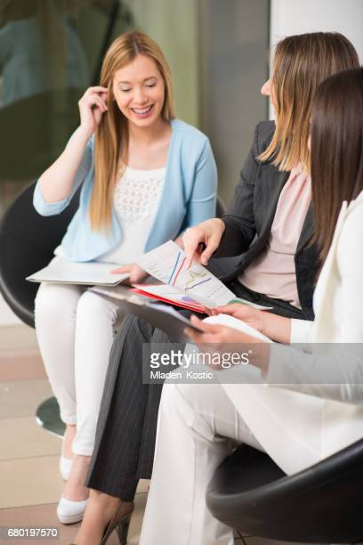 Businesswomen sitting in a  office lobby and waiting for meeting