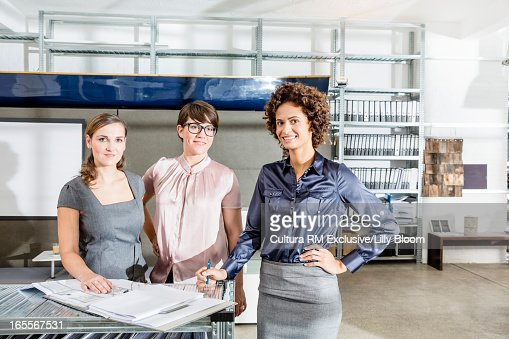 Businesswomen smiling in office : Stock Photo