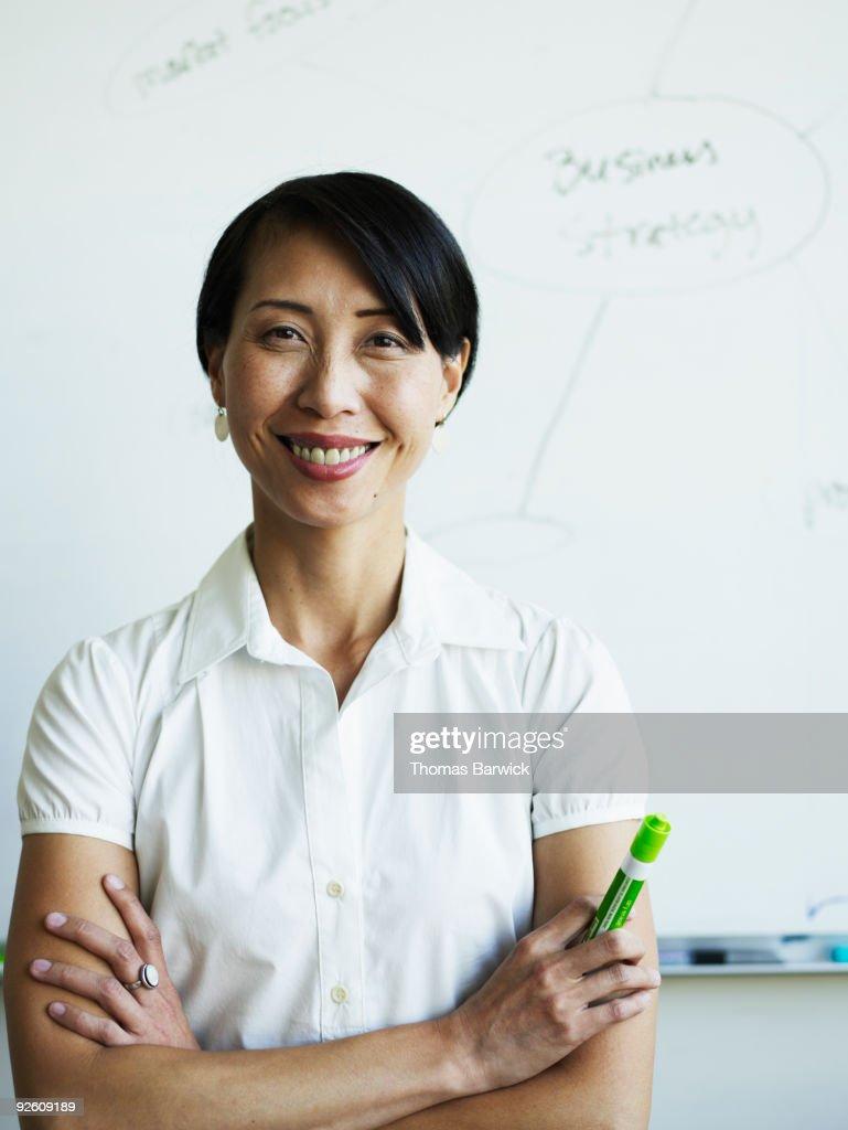 Businesswomen standing arms crossed : Stock Photo