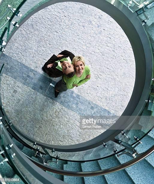 Businesswomen standing in stairwell