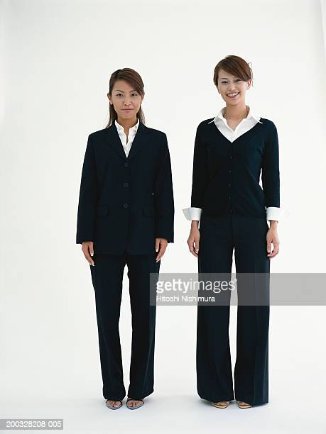 Businesswomen standing, smiling, portrait