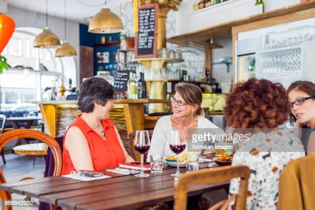 Businesswomen talking during lunch in restaurant