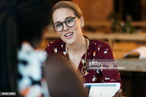 Businesswomen talking in cafe