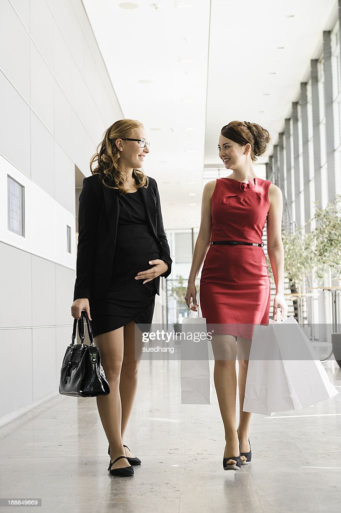 Businesswomen talking in lobby : Stock Photo